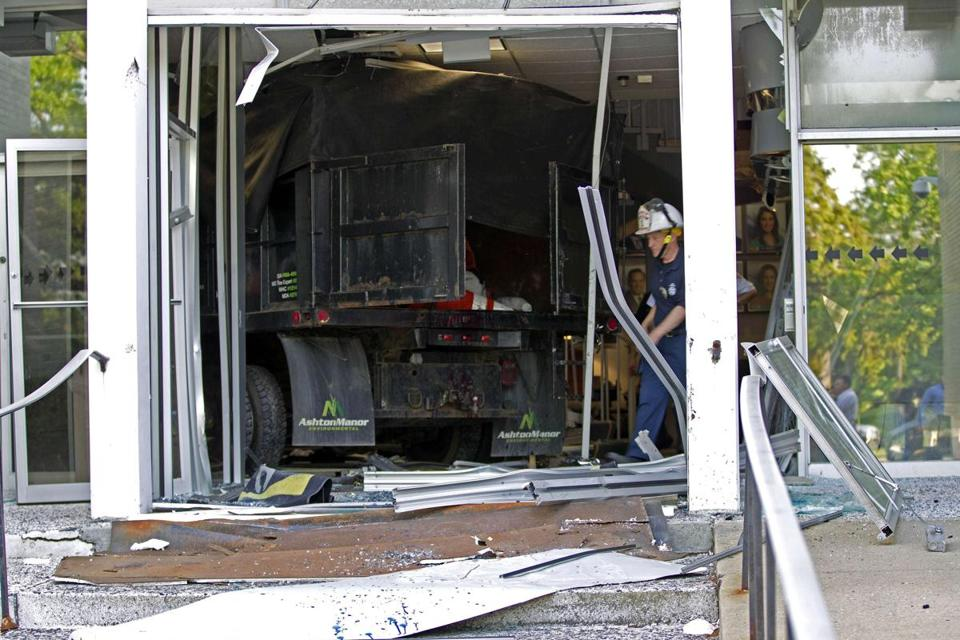 A huge hole remained in the front of WMAR-TV in Towson, Md., after a 29-year-old man drove into the lobby.