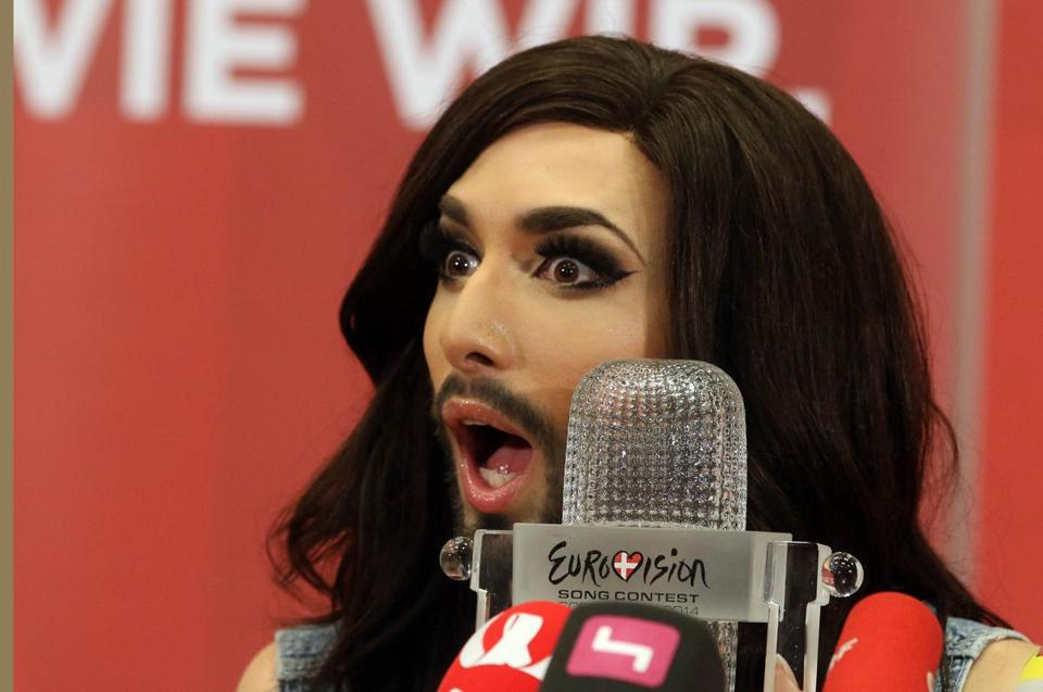 Austrian singer Conchita Wurst attends a press conference in Vienna, Austria Sunday May 11, 2014. Bearded drag queen Conchita Wurst has made a triumphant return to Austria after winning the Eurovision Song Contest in Copenhagen Saturday, in what the country's president called a victory for tolerance in Europe. (AP Photo/Ronald Zak)
