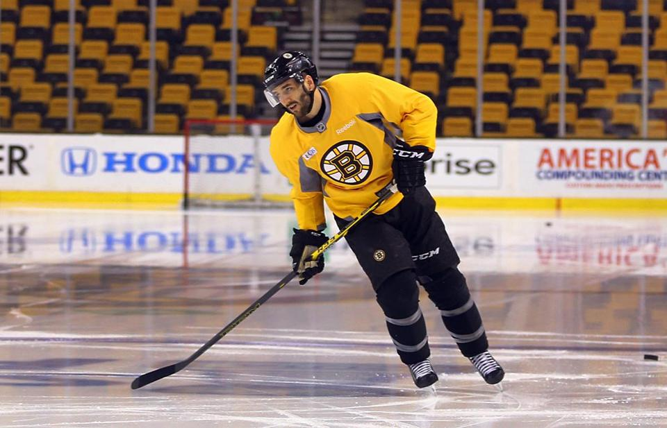 """It's always nice to get here, especially early to see the guys,"" said Patrice Bergeron. Boston Globe staff photo by John Tlumacki"
