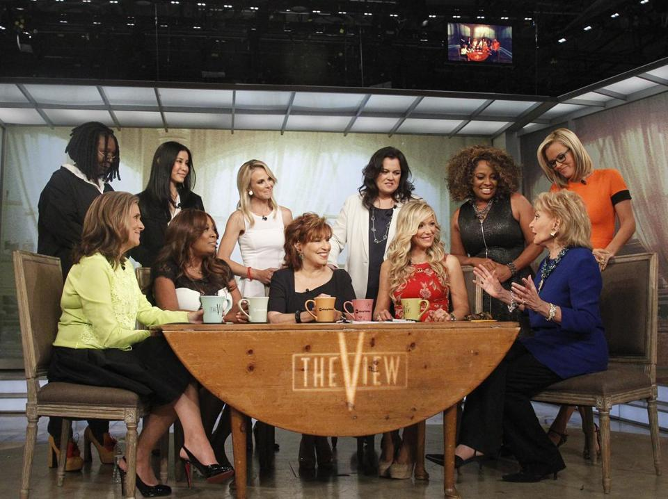 "(Back row, from left) Whoopi Goldberg, Lisa Ling, Elisabeth Hasselbeck, Rosie O'Donnell, Sherri Shepherd, and Jenny McCarthy; (Seated from left) Meredith Vieira, Star Jones, Joy Behar, Debbie Matenopoulos, and Barbara Walters on the set of ABC's ""The View."""