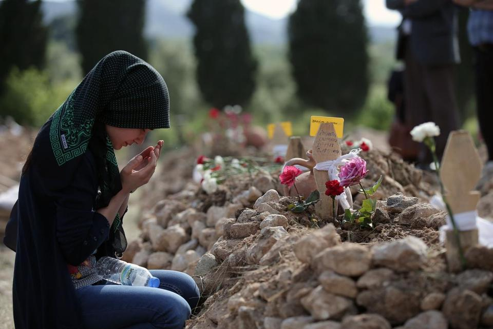 A woman prayed at the grave of Ibrahim Duman, 26, a victim of the mine accident.