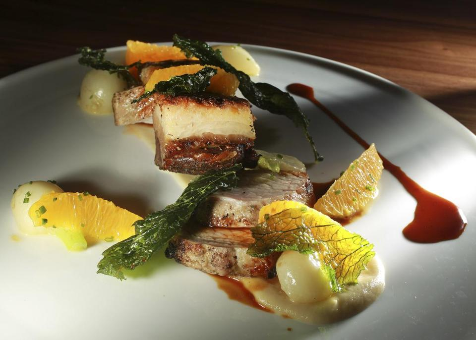 Roasted pork loin with pork belly, turnips, and citrus.