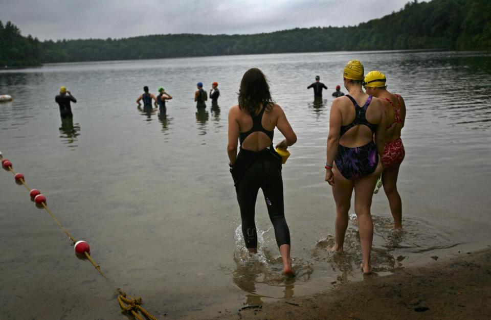 The state has scrapped an open-water swim ban at Walden Pond after protests. The photo above was taken at 6:18 a.m. on a July day in 2007; crossing the pond is a popular workout.