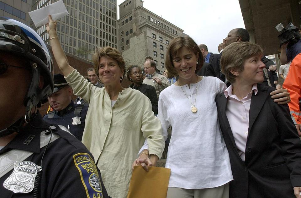Hillary and Julie Goodridge, left and center, emerged from Boston City Hall On May 17, 2004, with marriage papers in hand. Attorney Mary Bonanto, right, accompanied them.