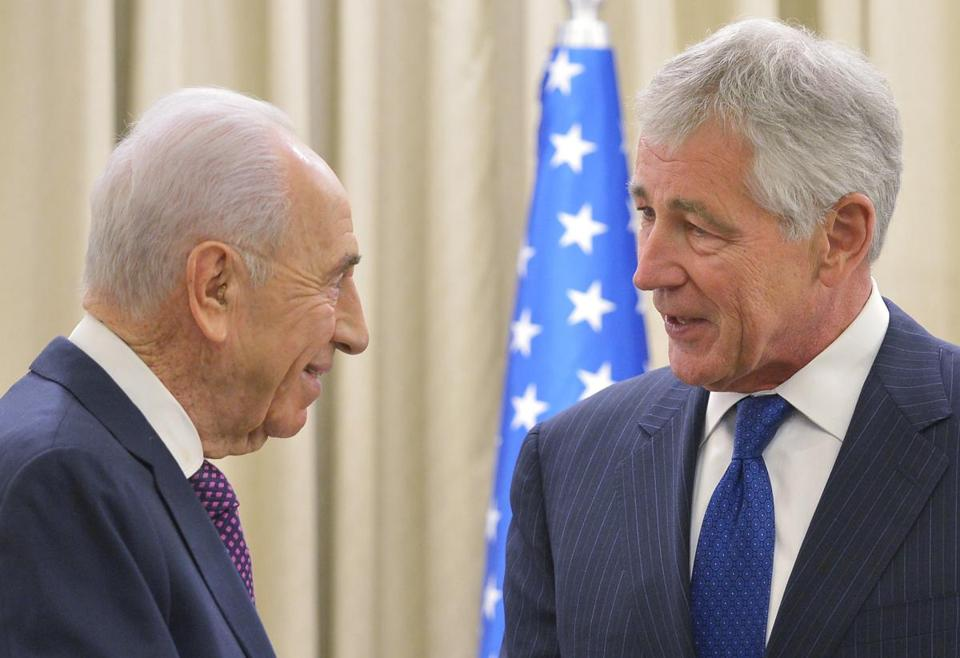 Israeli President Shimon Peres (left) greeted US Defense Secretary Chuck Hagel before talks Friday at the Israeli presidential residence in Jerusalem.