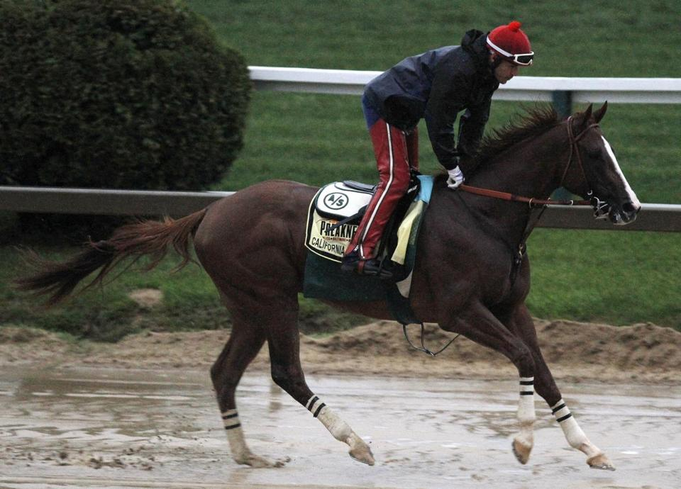 Preakness favorite California Chrome galloped 2 miles at rain-soaked Pimlico on Friday.