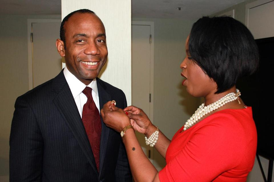 Roslyn Brock, head of the NAACP directors, put a pin on new president Cornell William Brooks on Saturday.
