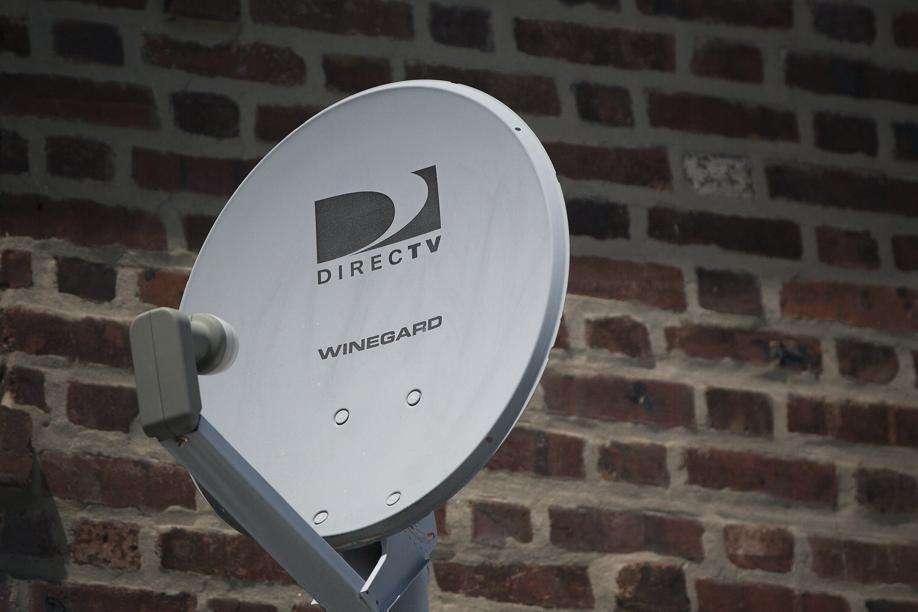 A DirecTV dish outside a home.