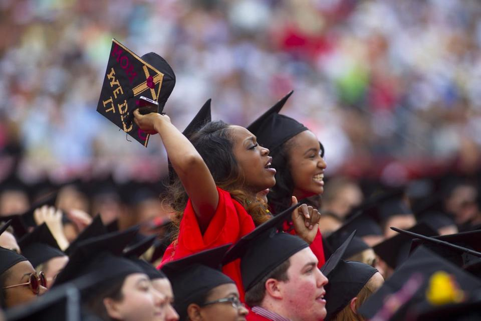 Chelsea Roberts, left, and Cherice Hunt cheered on a classmate Sunday during Boston University's 141st commencement. Governor Deval Patrick and Secretary of State John F. Kerry were among the dignitaries who offered advice to graduates across New England as they started new chapters of their lives.