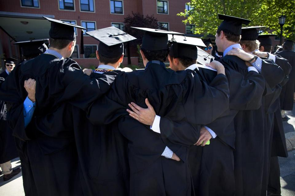 Tufts University students pose for a photo at their May commencement ceremony.