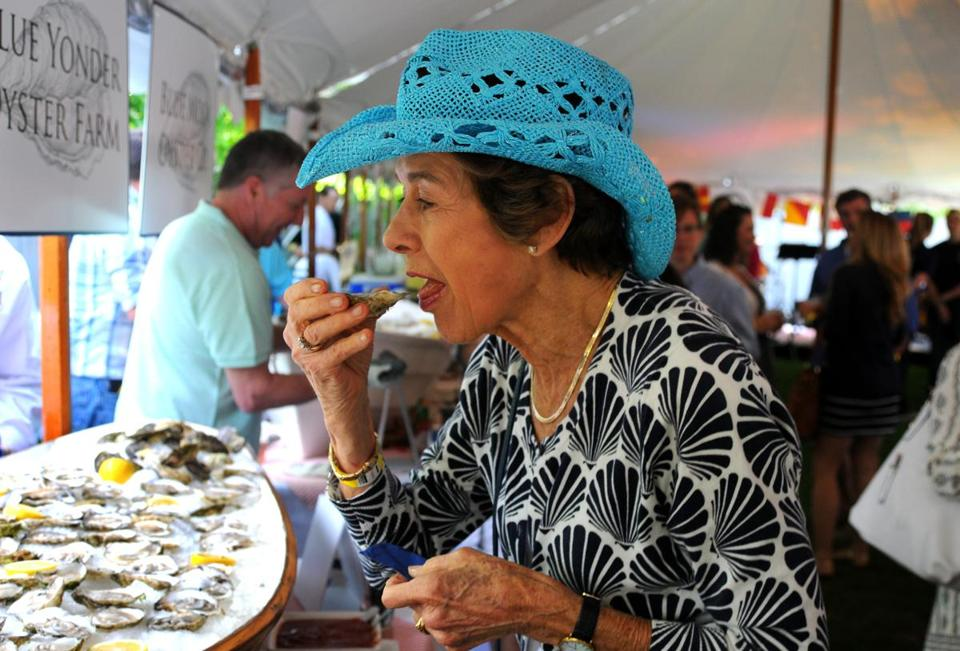 Duxbury's Shirley Jenkins samples an oyster at the Duxbury Oyster Festival at Winsor House Inn.