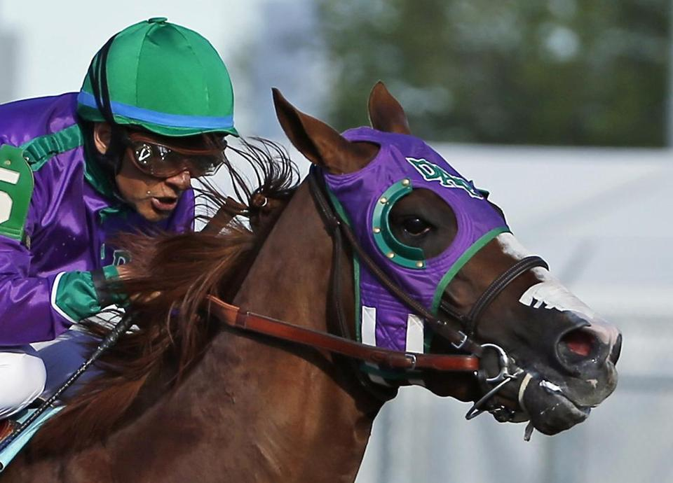California Chrome, under jockey Victor Espinoza, wins the Kentucky Derby sporting his Flair nasal strip. AP Photo/Matt Slocum, File