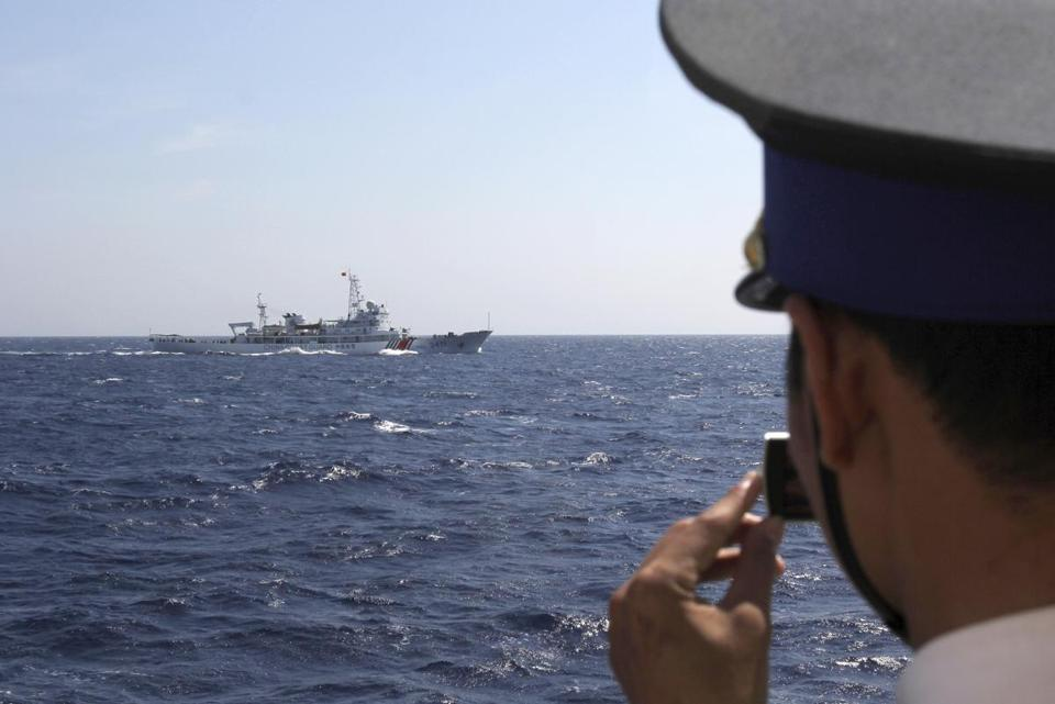 A Vietnamese Coast Guard officer took a picture of a China Coast Guard ship moving toward his vessel, which is near the site of a Chinese drilling oil rig being installed in disputed water.