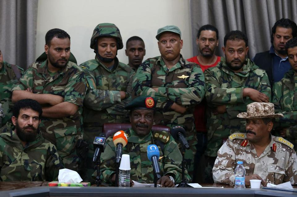 Libyan commander Wanis Khamada (front center) said that he has allied with Khalifa Hifter, a renegade general.