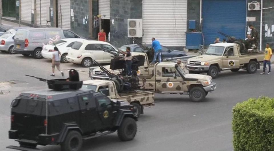 Security forces on vehicles with heavy artillery guarded the entrance road to the Libyan Parliament in Tripoli.