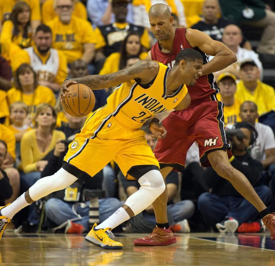 Indiana's Paul George works around the defense of Miami's Shane Battier during Game 1.