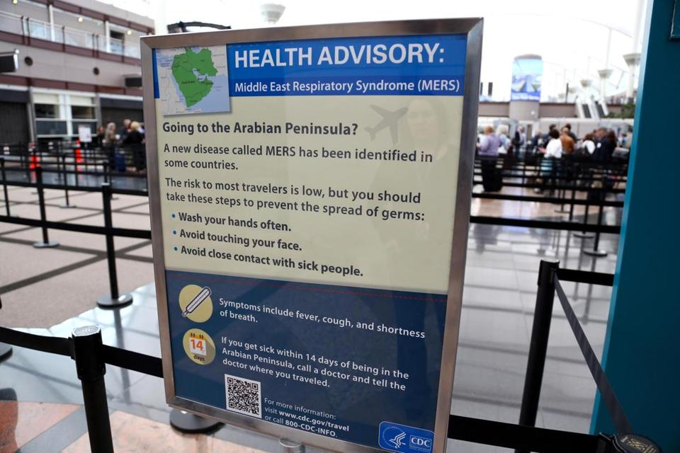 Newly erected signs warning travelers about he danger of the MERS virus, at Denver International Airport