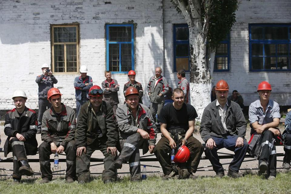Employees of the Ilyich Iron and Steel Works protested the  actions of armed separatists in Mariupol on Tuesday.