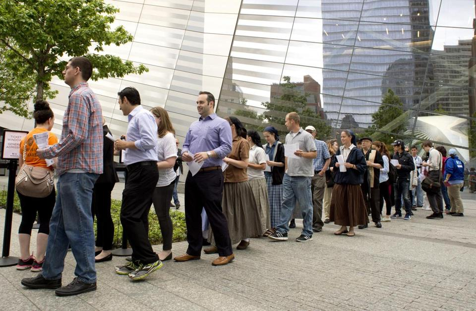People line up to enter the 9/11 Memorial Museum on public opening day Wednesday in New York.