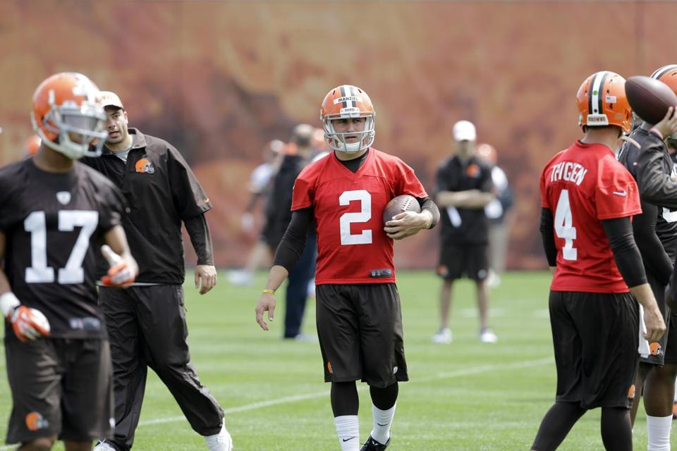 Rookie quarterback Johnny Manziel (2) will enter training camp as back up in Cleveland.
