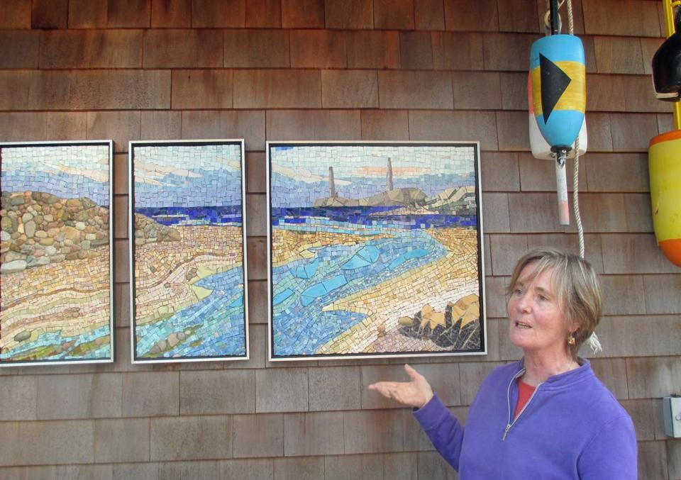 "Artist with panels: Artist Pam Stratton with her piece, ""Twin Lights."" (Diane Bair for The Boston Globe)"