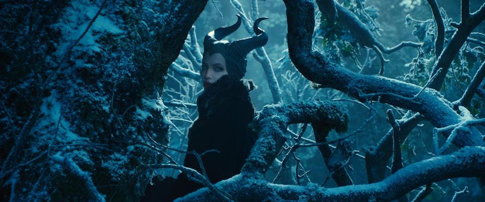 "Disney Studio's 'Maleficent,' starring an supremely arch Angelina Jolie, offers a deeper backstory on the horned evil sorceress of the classic ""Sleeping Beauty."""