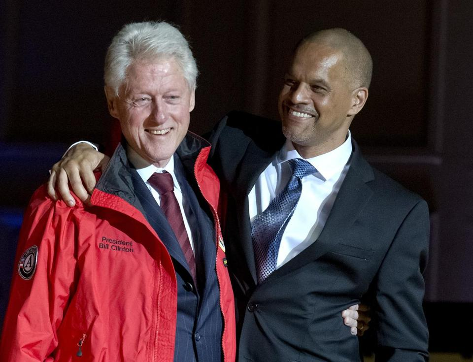 Bill Clinton shared a hug with Stephen Spaloss, City Year's regional vice president, after getting the award.