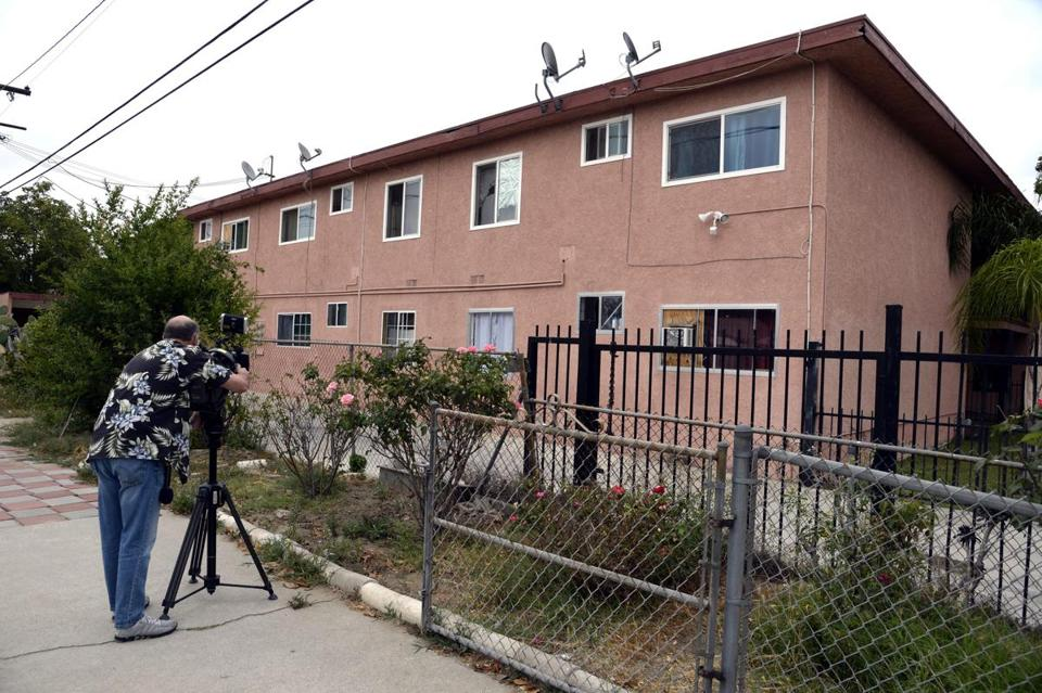 A television cameraman filmed the apartment complex in the city of Bell Gardens.