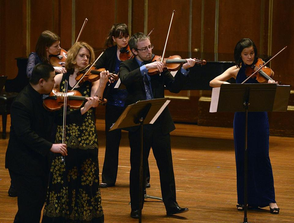 "A Far Cry performing at Jordan Hall on Friday night. The program ranged from a version of the ""Psycho'' film score to a rendering of Aaron Copland's Suite from ""Appalachian Spring."""
