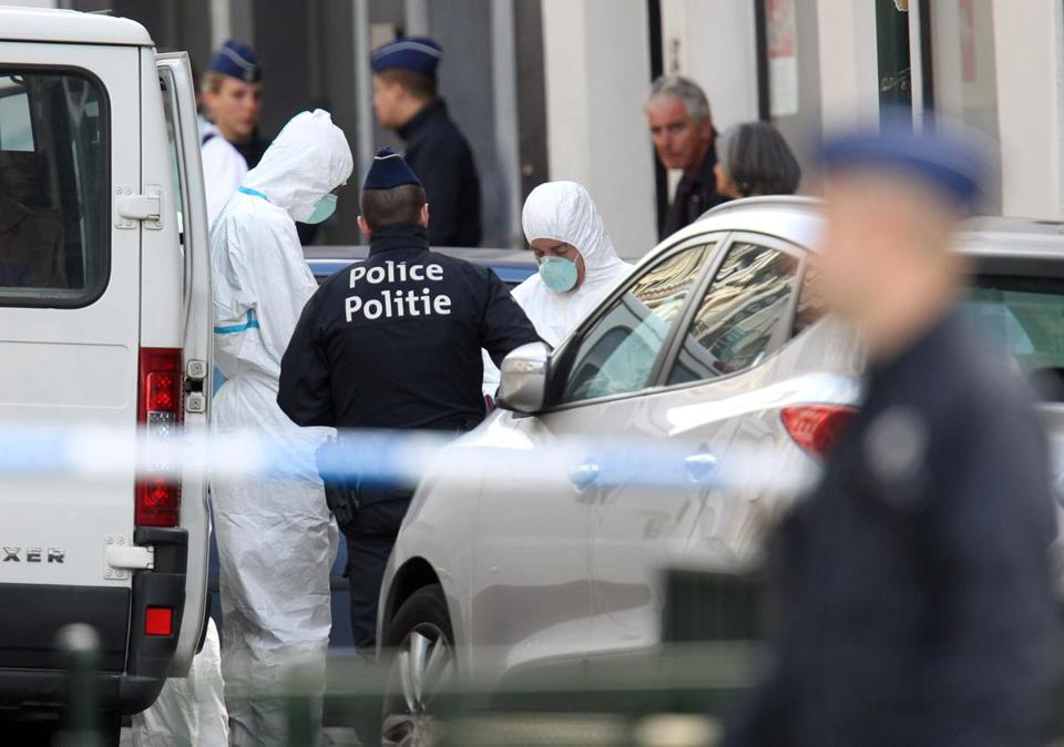 Crime scene investigators worked in a cordoned-off area after a shooting at the Jewish Museum in Brussels on Saturday. Three people died and a fourth was seriously wounded.