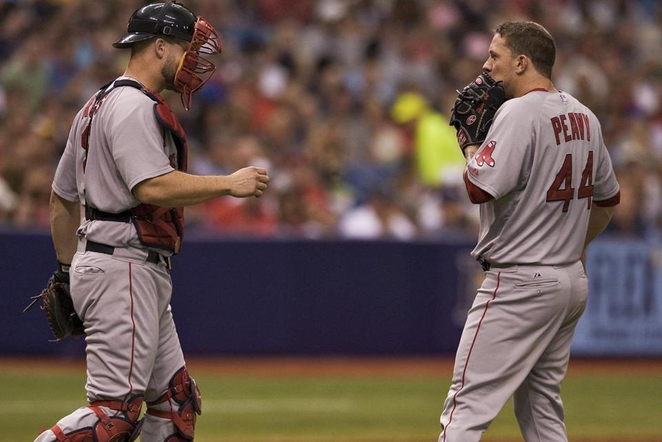 Catcher David Ross (left) chats with Sox starter Jake Peavy in the fifth inning as the Rays finished erasing a five-run deficit. (Steve Nesius/AP)
