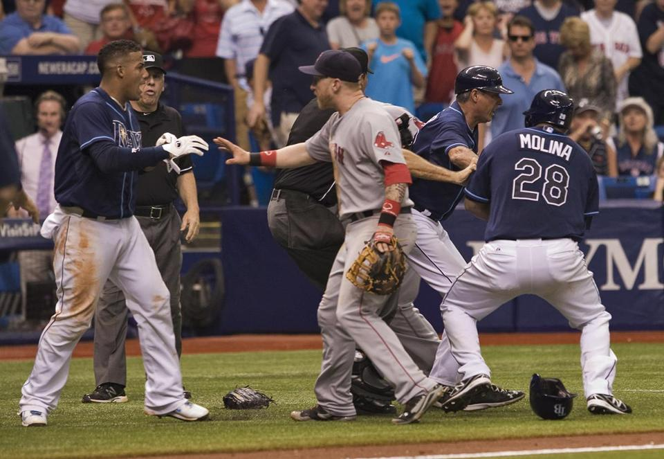 Red Sox first baseman Mike Carp (center) confronts the Rays' Yunel Escobar during a seventh-inning brawl. Steve Nesius/Associated Press
