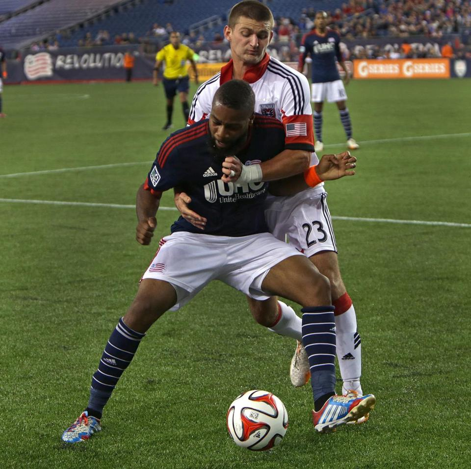 D.C. United's Perry Kitchen (23) put the wraps on New England's Andrew Farrell.