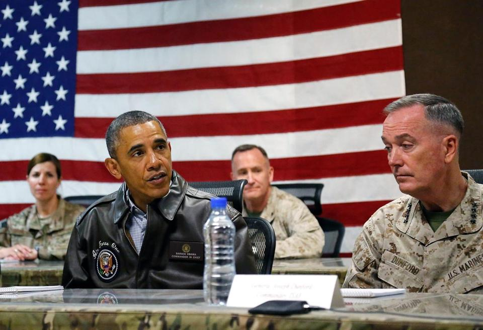 President Obama sat for a military briefing with US Marine General Joseph Dunford (right) during an unannounced visit to Afghanistan.