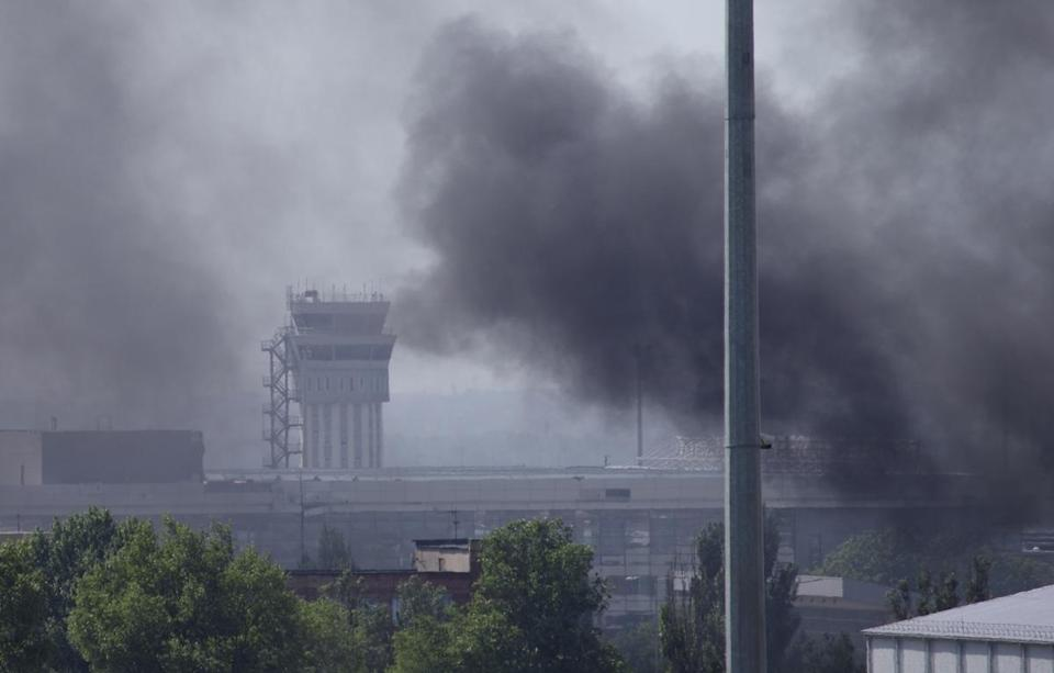 Smoke rises from the airport outside Donetsk, Ukraine on Monday.