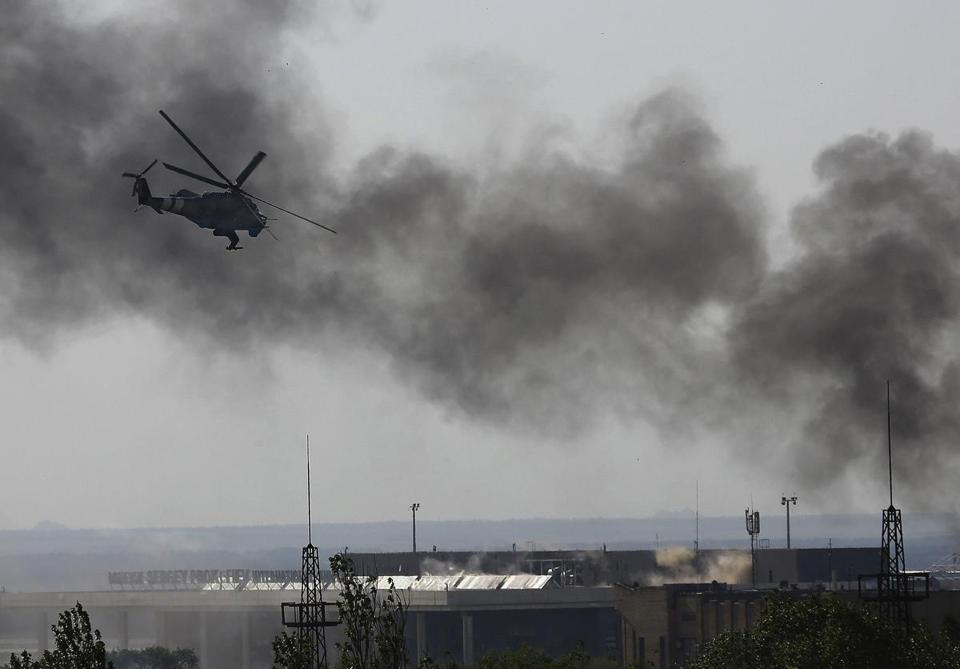 A Ukrainian Mi-24 helicopter gunship fired against rebels at the main terminal building of Donetsk International Airport Monday. Rebels had seized the airport after Petro O. Poroshenko was elected president of Ukraine in a landslide Sunday.