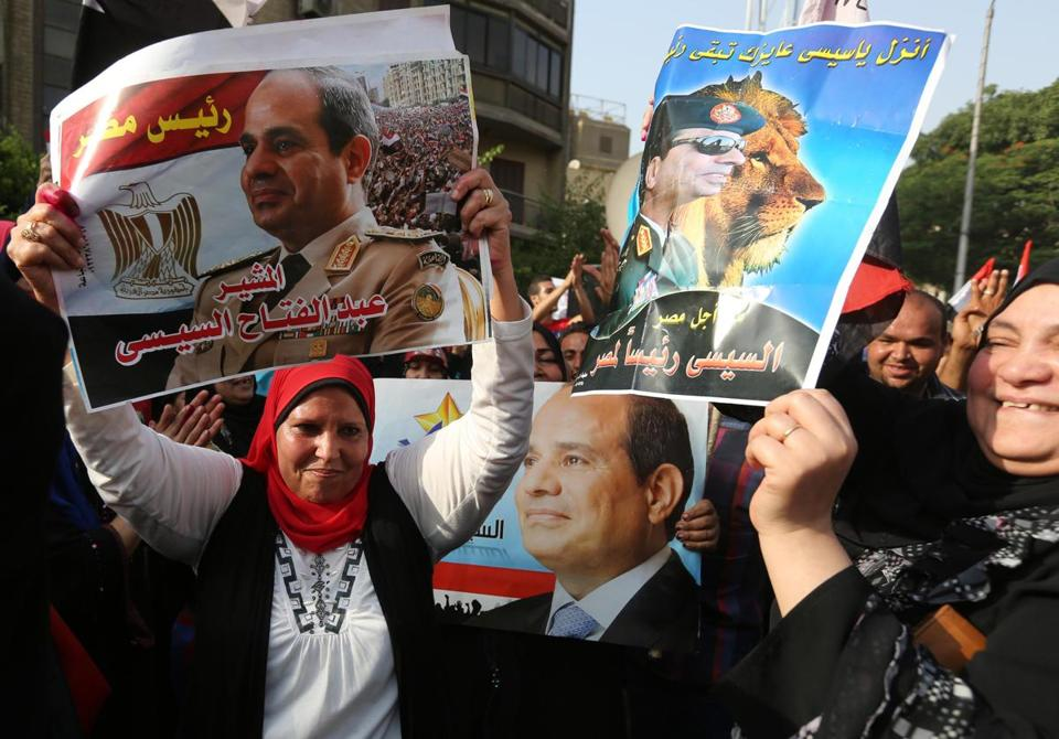 Voters celebrated at a polling station in Cairo Monday in the first day of a two-day election that is expected to sweep former military chief Abdel-Fattah el-Sissi into the presidency.