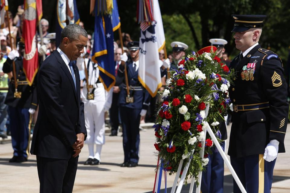 President Obama took part in a wreath-laying ceremony Monday at Arlington cemetery.