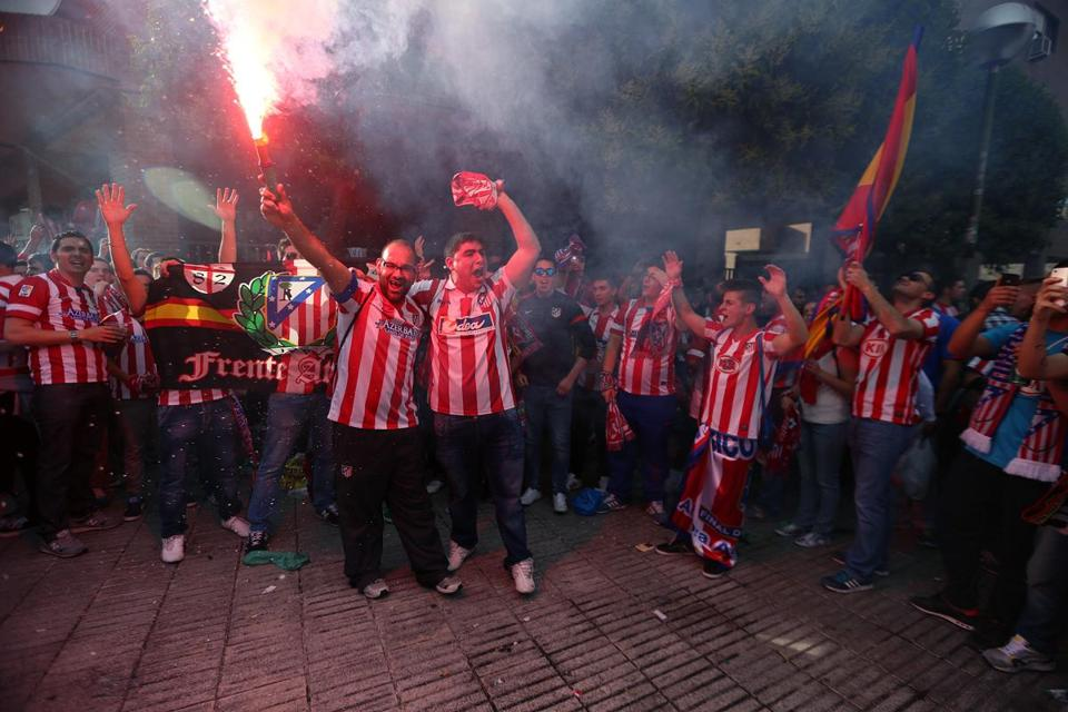 Atlético Madrid fans celebrate in block party fashion on Paseo de los Melancolicos, Madrid, prior to the start of the UEFA Championship final on May 24, 2014.