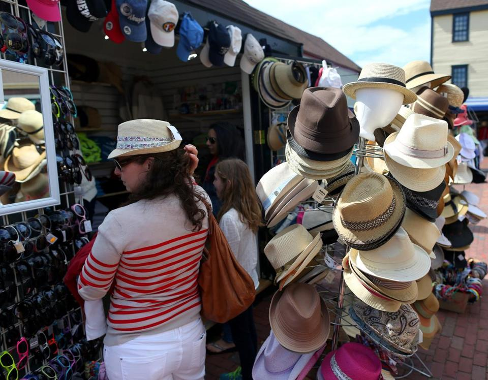 Hat shoppers stroll through Newport, R.I., on Memorial Day weekend.