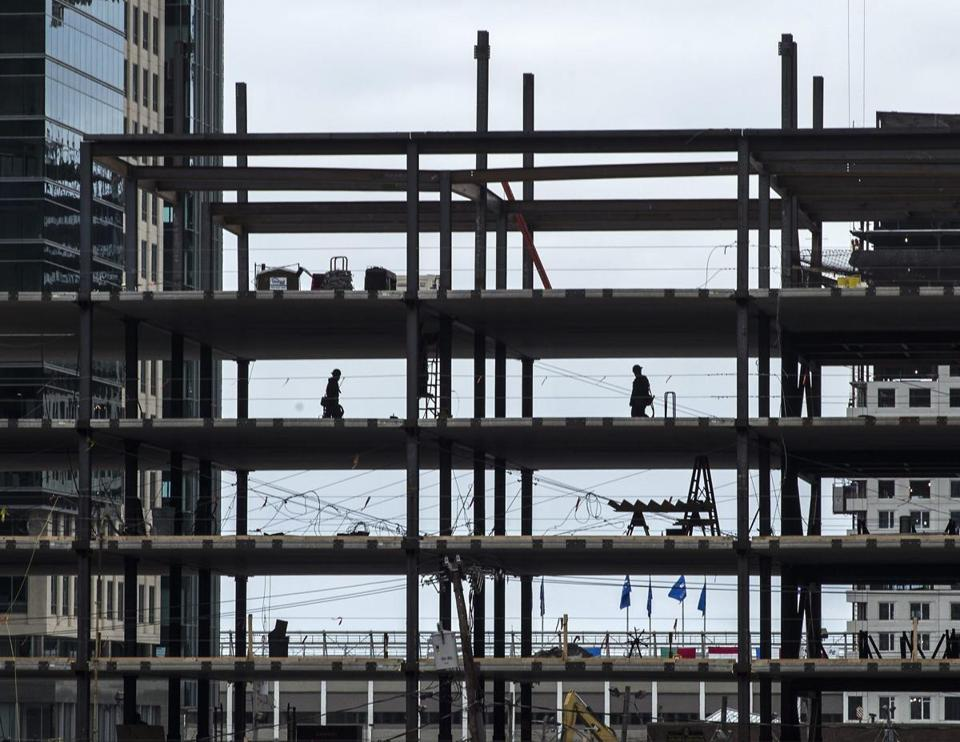 Workers constructed a new building in the Seaport District.