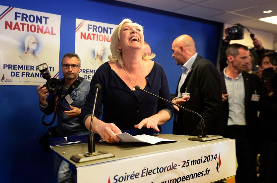 In France, Front National party president Marine Le Pen reacts to the party's election success Sunday.