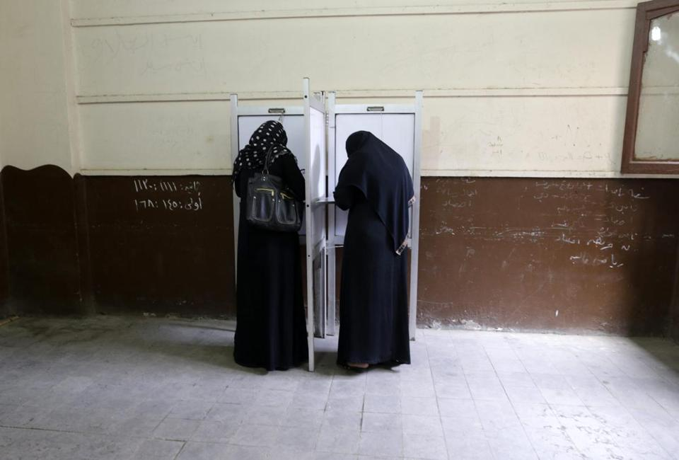 Egyptian women filled out ballots in the presidential elections at a polling station of the al-Gamaleya area, in Cairo.