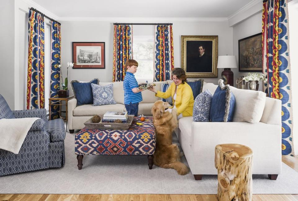 Julia and her youngest son hang out in the family room, where the furnishings can take the wear and tear of three active boys and the family's golden retriever.