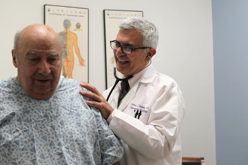 Dr. Arthur P. Rabinowitz, director of Lahey Hospital's stem cell transplant program, examined patient Joe Damato of Haverhill.