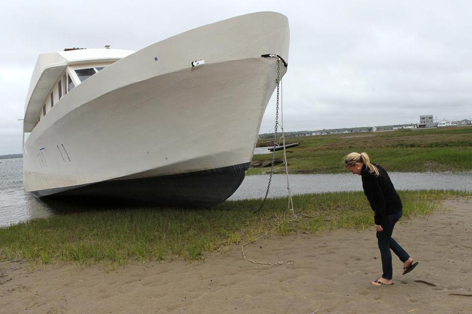 A yacht that ended up on a beach near Alicia Preston's house in Hampton, N.H., has been the topic of rumors.