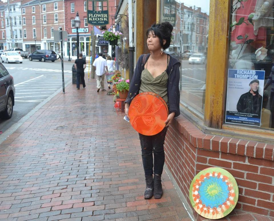 Marisa Kang, 21, a New Jersey-born visual artist and musician, leaves pieces of her art in downtown Portsmouth for people to find and keep.