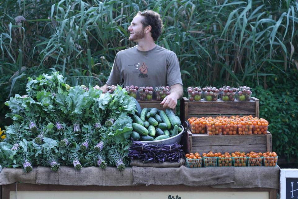 Lucas Dinwiddie of Halcyon Farm in Brewster with his bounty at the Wellfleet Farmers' Market in 2012.