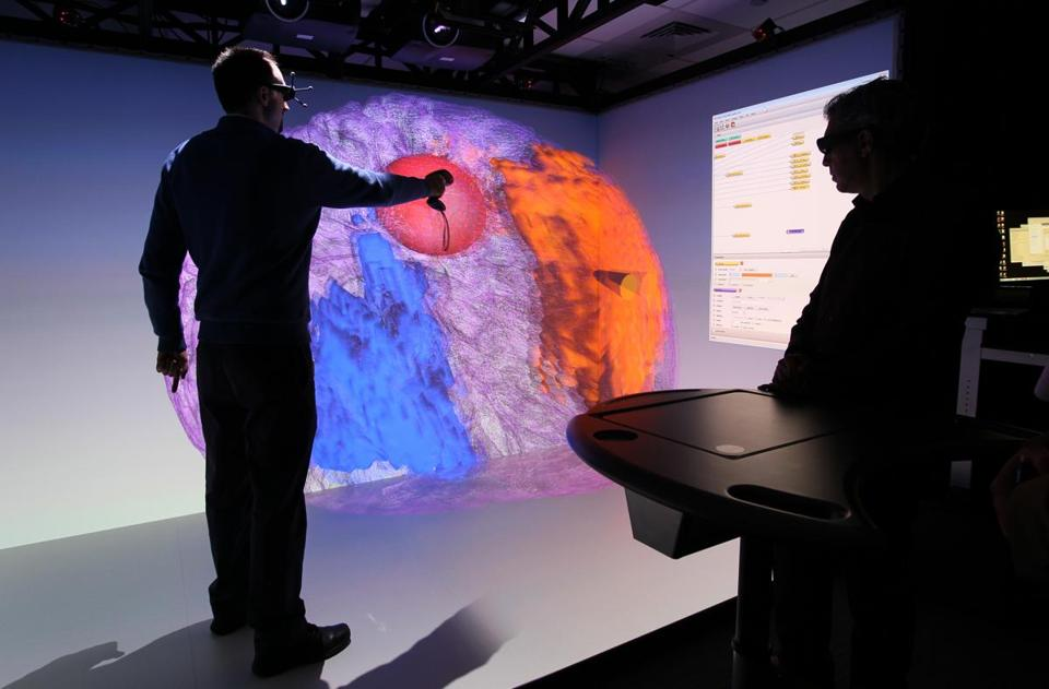 Pfizer chemist Kevin Hallock rotated a 3-D image of a human brain projected on a giant screen.