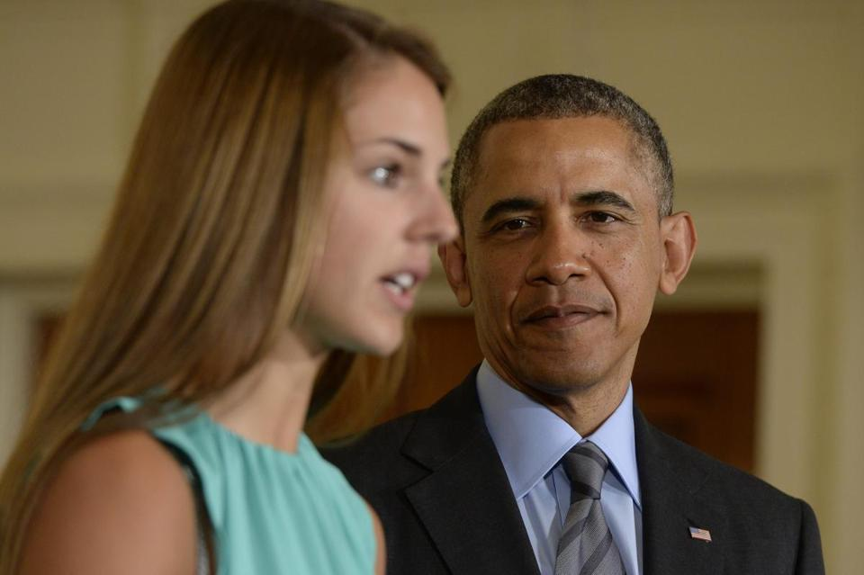 President Obama listens to the story of Victoria Bellucci, who suffered five concussions during her soccer career.
